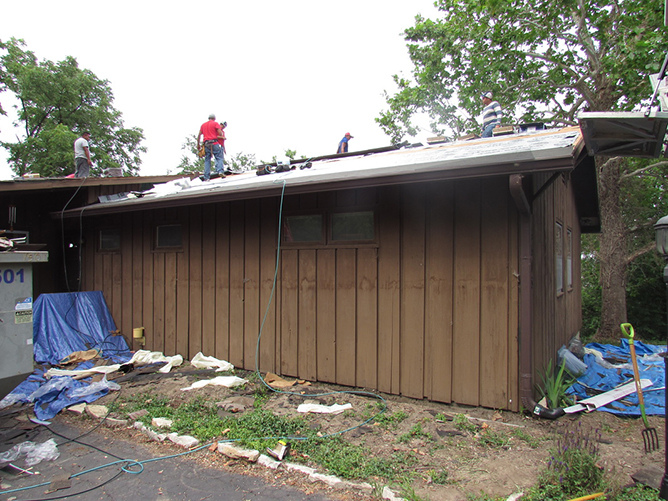 Before. Old cedar siding during roof replacement